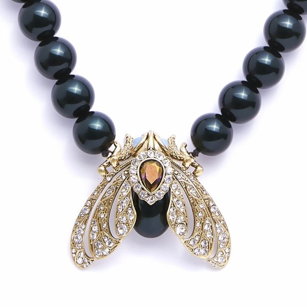 moth statement necklace